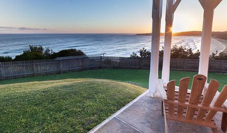 Sunset over the ocean from Head Keeper's cottage verandah in Myall Lakes National Park. Photo: Seal Rocks Lighthouse Cottages