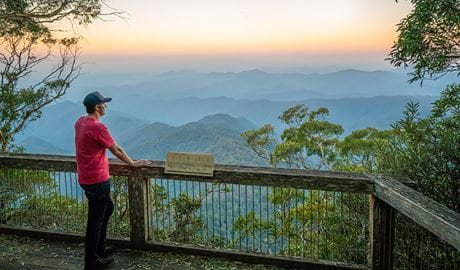 Visitor looking at views of New England National Park from Point Lookout. Photo: John Spencer/OEH