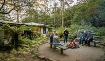 Group of friends sititng around the fire pit at The Residence in New England National Park. Photo: John Spencer/OEH