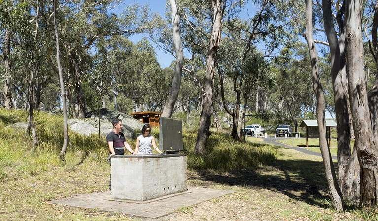 Two people at the barbecue, Threlfall picnic area, Oxley Wild Rivers National Park. Photo: Leah Pippos ©DPIE
