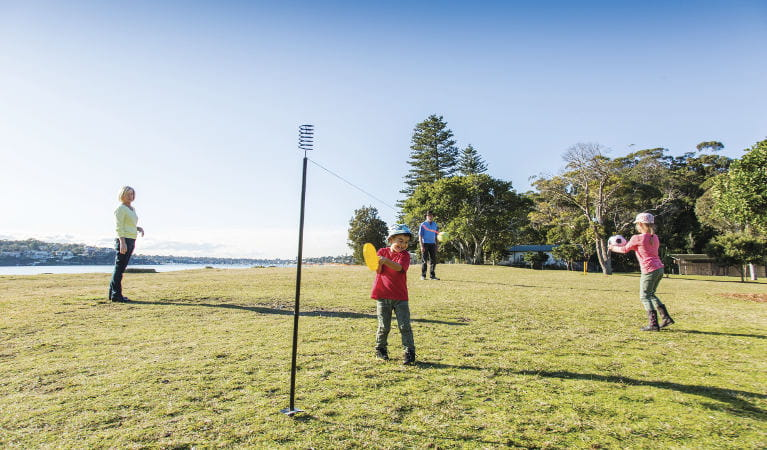 A family playing ball games on the grass at Bonnie Vale picnic area in Royal National Park. Photo: Simone Cottrell/OEH