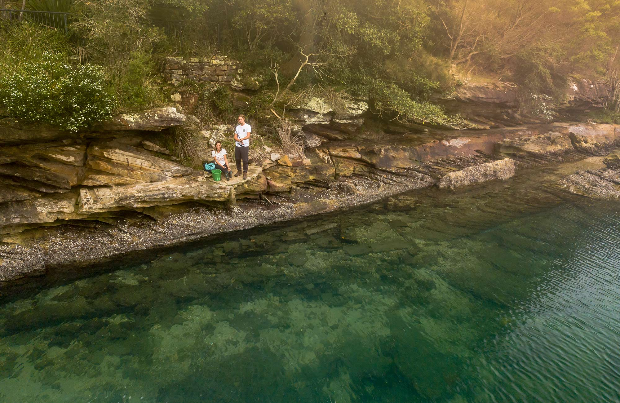 A couple fishing by Port Hacking River, near Weemalah Cottage, Royal National Park. Photo: John Spencer/OEH