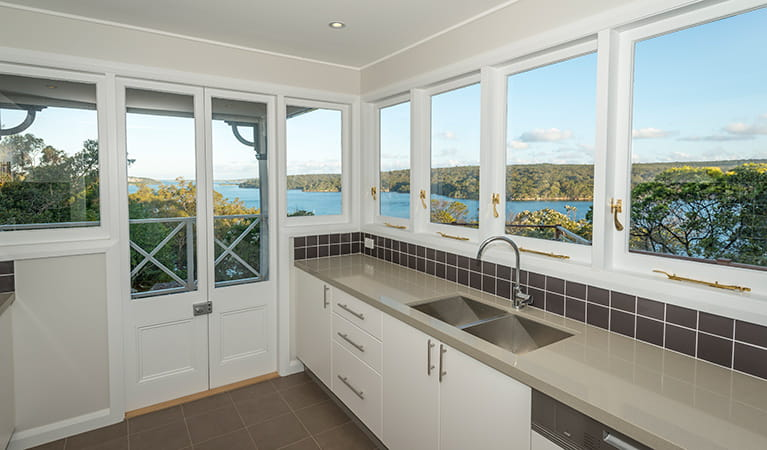 The kitchen with view of Port Hacking in Hilltop Cottage, Royal National Park. Photo: John Spencer © DPIE