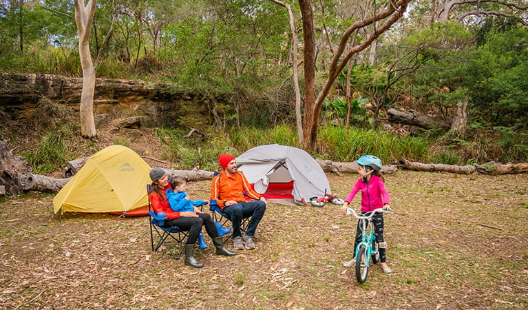 Family with young kids camping in Royal National Park. Photo: John Spencer/OEH