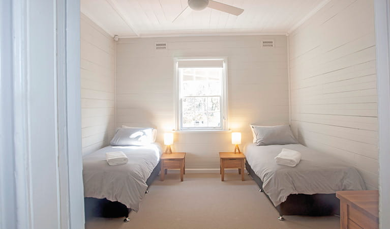 A bedroom with 2 single beds in Reids Flat Cottage, Royal National Park. Photo: Rosie Nicolai/DPIE