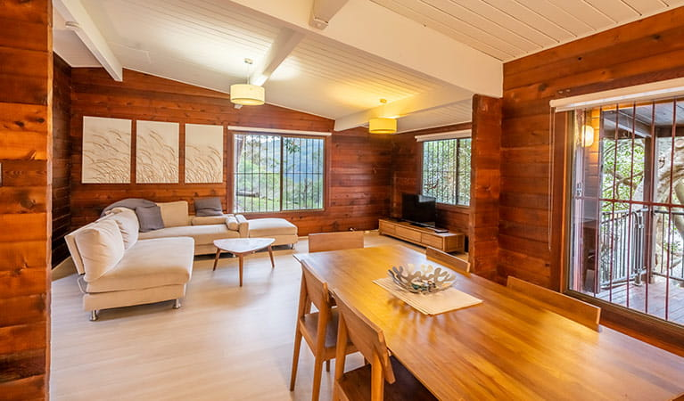 Open plan lounge and dining room at Weemalah Cottage, Royal National Park. Photo: John Spencer/OEH