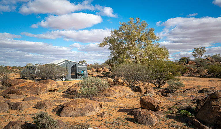 Camper trailer and boulders at Dead Horse Gully campground in Sturt National Park. Photo: John Spencer/DPIE