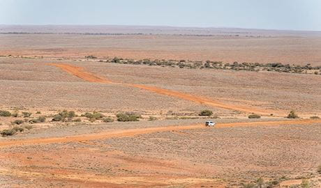 Aerial view of  a 4WD driving along Middle Road Drive in Sturt National Park. Photo: John Spencer/DPIE