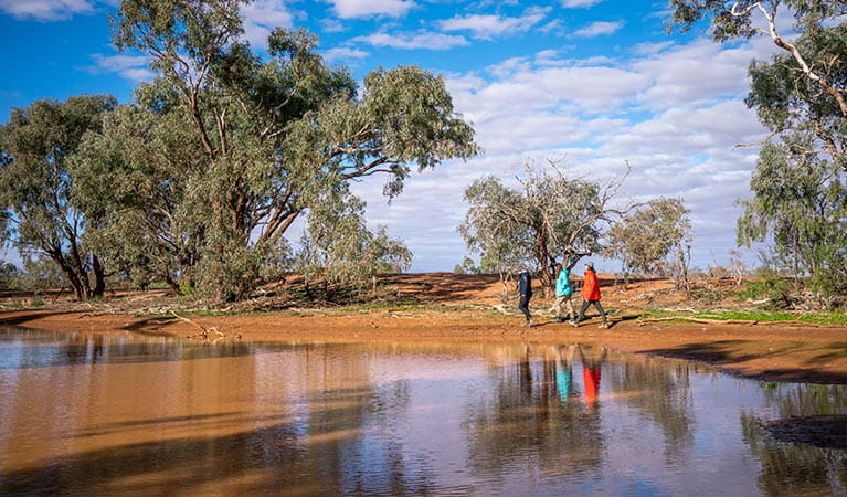 Friends walking along the bank of the billabong at Mount Wood campground. Photo: John Spencer/DPIE