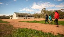 Group of friends walking outside Mount Wood Shearers Quarters. Photo: John Spencer/DPIE