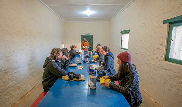 Group of students in the communal eating area, Mount Wood Shearers Quarters. Photo: John Spencer/DPIE