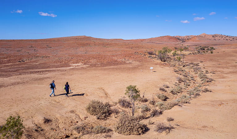 Walkers at the start of Mount Wood Summit walking track in Sturt National Park. Photo: John Spencer/DPIE