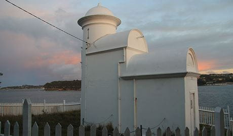 Grotto Point lighthouse at sunset overlooking Sydney Harbour. Photo: OEH/Natasha Webb