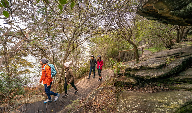 Friends walk along Hermitage Foreshore track, Sydney Harbour National Park. Photo: John Spencer/OEH