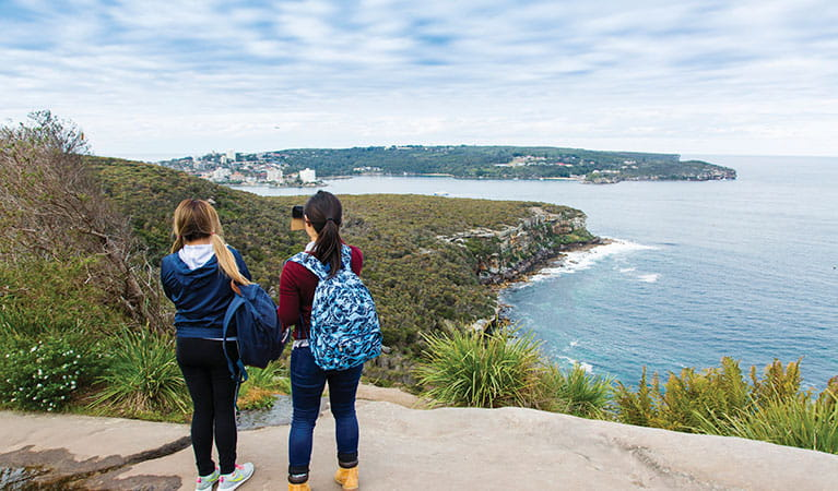2 friends enjoying the view of Manly and Q Station at Dobroyd Head along Manly scenic walkway in Sydney Harbour National Park. Photo: Simone Cottrell/DPIE