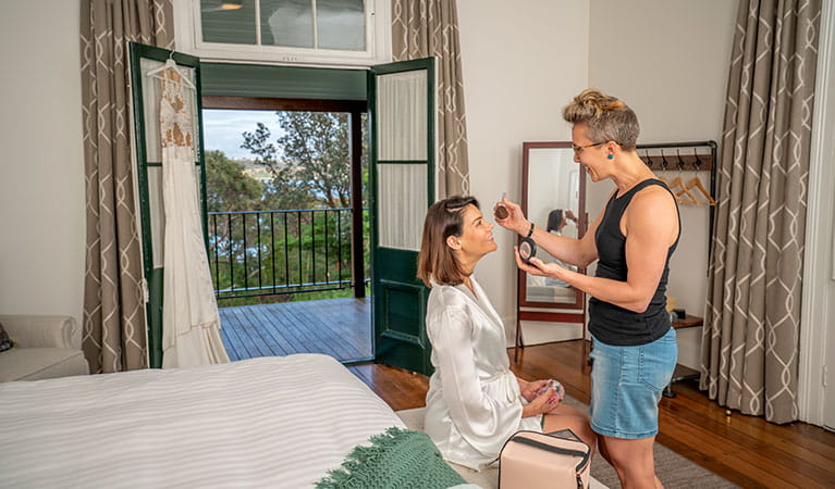 A bride having her make-up done in the master bedroom of Middle Head Officers Quarters, Sydney Harbour National Park. Photo: John Spencer/DPIE