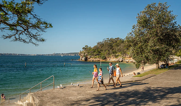 Family walking on the path next to Shark Beach in Nielsen Park. Photo: John Spencer/DPIE