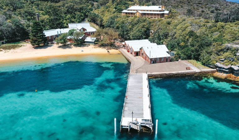 Aerial view of Q Station wharf and buildings in Sydney Harbour National Park. Photo: Q Station