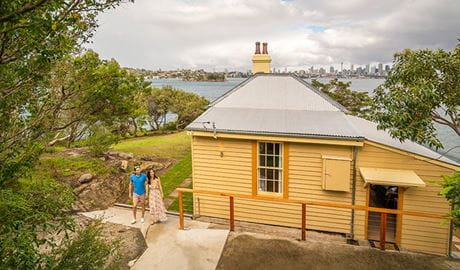 View of Steele Point Cottage from the embarkment with the Sydney Harbour skyline in the distance. Photo: John Spencer/OEH