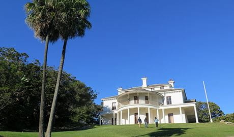 People walking up the lawn to Strickland House, Sydney Harbour National Park. Photo: E Sheargold/OEH