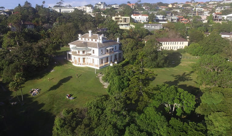 Aerial view of Strickland House and grounds, with picnickers relaxing on the lawn, Sydney Harbour National Park. Photo: Tommy Ramsay