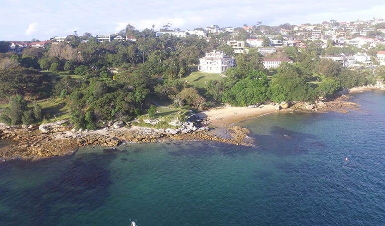 Aerial view showing the harbour foreshore, Milk Beach and Strickland House, Sydney Harbour National Park. Photo: Tommy Ramsay