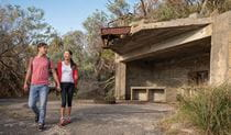 Young couple on Fort Tomaree walk in Tomaree National Park. Photo: J Spencer/OEH