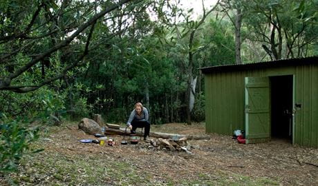 A camper at Balor Hut campground in Warrumbungle National Park. Photo: OEH