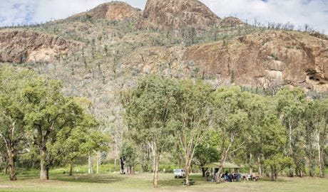 A group enjoying a picnic beside their car at Canyon picnic area, Warrumbungle National Park. Photo: Simone Cottrell/RBG