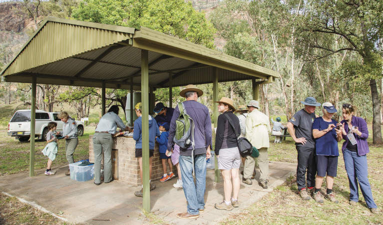 A group enjoying a barbecue at Canyon picnic area in Warrumbungle National Park. Photo: Simone Cottrell/RBG