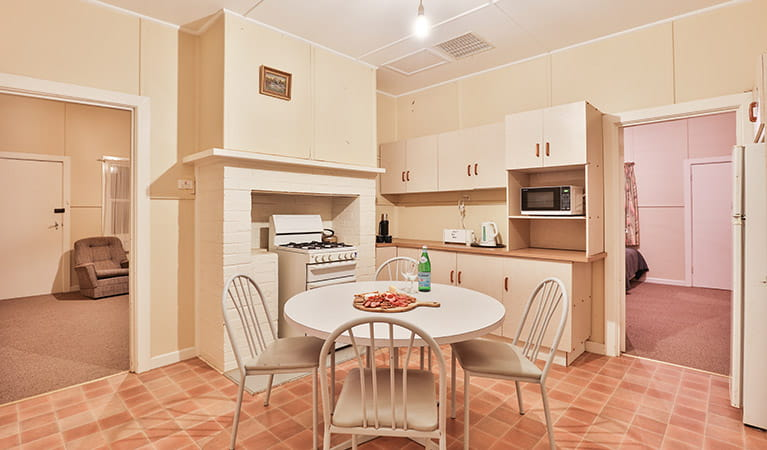 Kitchen and dining table at Willandra Cottage, Willandra National Park. Photo: Vision House Photography/DPIE