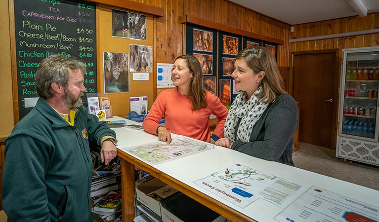 NSW National Park staff answering questions from visitors at Kui Kiosk. Photo: OEH/John Spencer