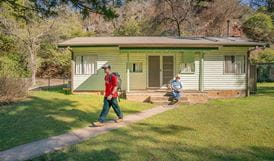 Family sets off to go hiking from Post Office cottage. Photo: OEH/John Spencer