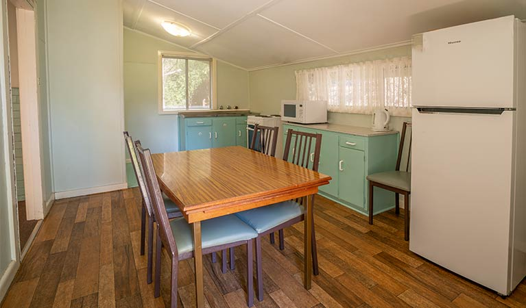 Cottage office Contemporary Modern Kitchen Of Post Office Cottage With Dining Table Fridge Oven And Microwave Photo Reillys Wines Post Office Cottage Nsw National Parks