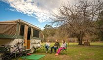 Family with caravan at Wombeyan Caves campground. Photo: OEH/John Spencer