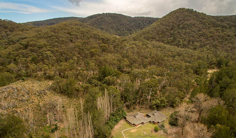 Arial view of Wombeyan Caves dorms set in the bushland hills. Photo: OEH/John Spencer