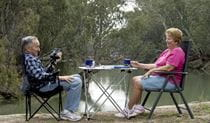 Two grey nomad travellers in Mamanga campground. Photo: Boris Hlavica/NSW Government