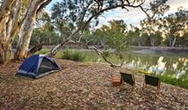 A tent and 2 campchairs overlook the river at Woolpress bend campground, Yanga National Park. Photo: Vision House Photography/OEH