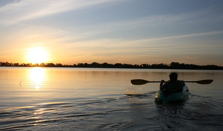 A kayaker on Yanga Lake at sunset, Yanga National Park. Photo: Martin Kendall/OEH