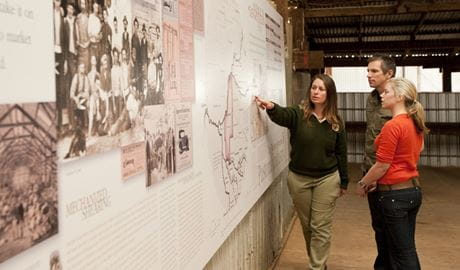Ranger showing visitors a display in Yanga Woolshed. Photo: Rob Blackburn.