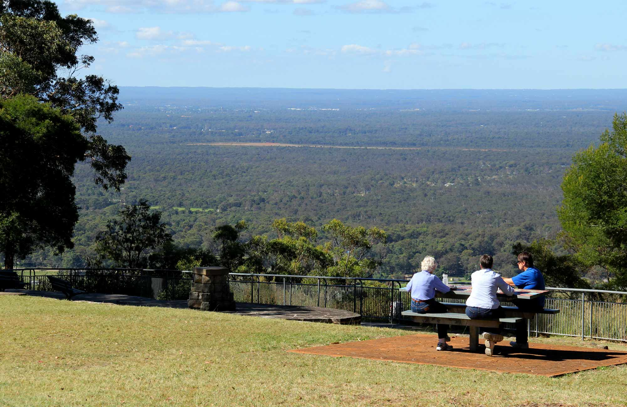People sitting at a table at the Hawkesbury Lookout. Photo: John Yurasek