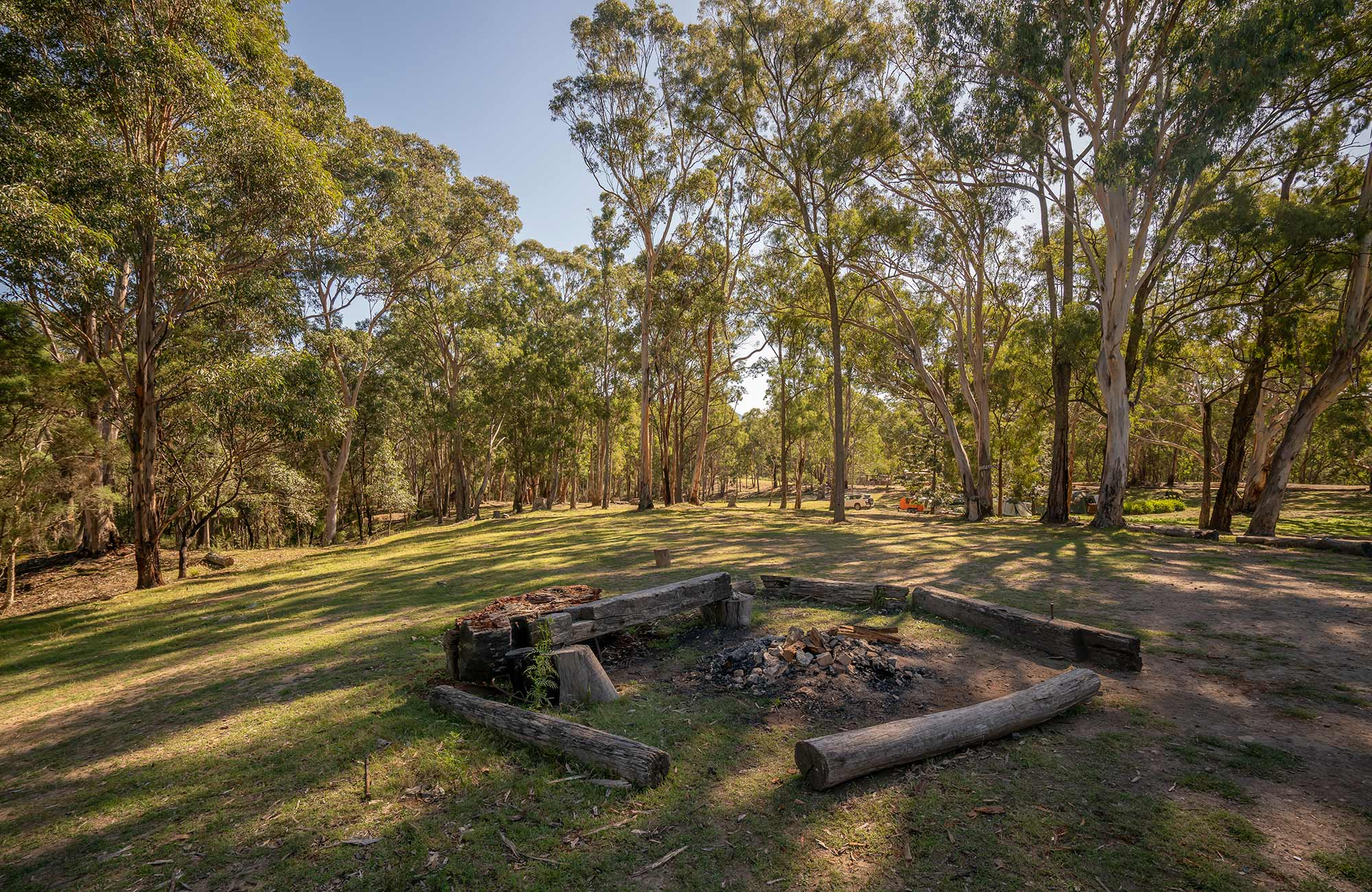 Fire pit surrounded by log seats at Private Town campground in Yerranderie Regional Park. Photo: John Spencer/OEH