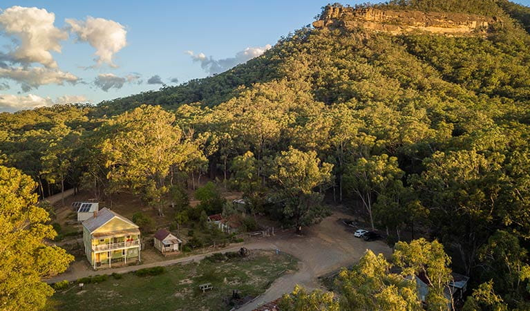 Arial view of Post Office Lodge in Yerranderie Private Town, surrounded by the rugged landscapes of Yerranderie Regional Park. Photo: John Spencer/OEH