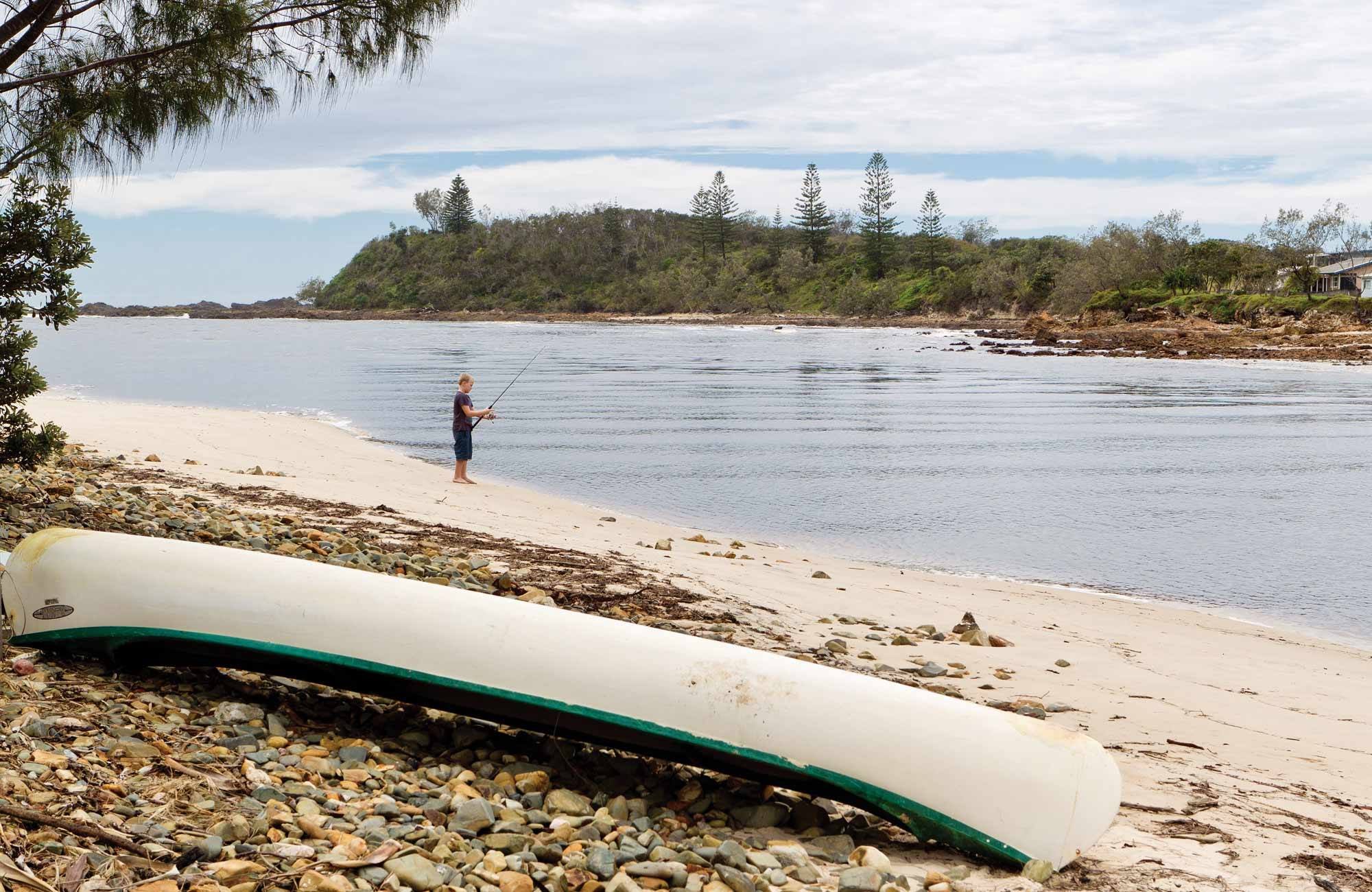 Fisherman and kayak at Sandon River Camping Area. Photo: Rob Cleary