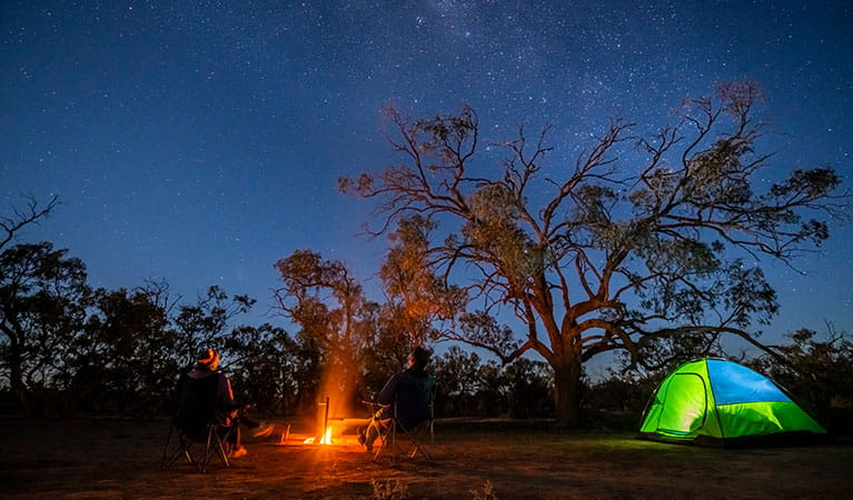 Tent and campfire at Emu Lake campground in Kinchega National Park. Photo: John Spencer © DPIE