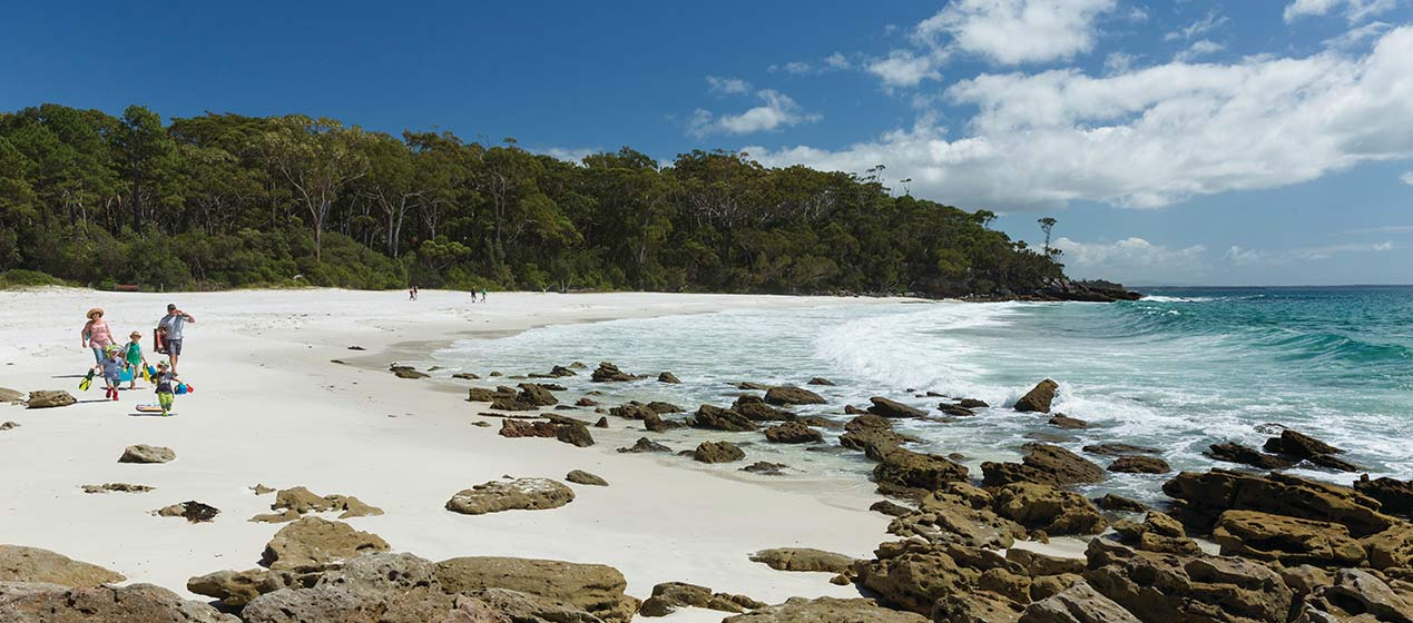 A family play on a beach at Jervis Bay National Park. Photo: David Finnegan © DPIE