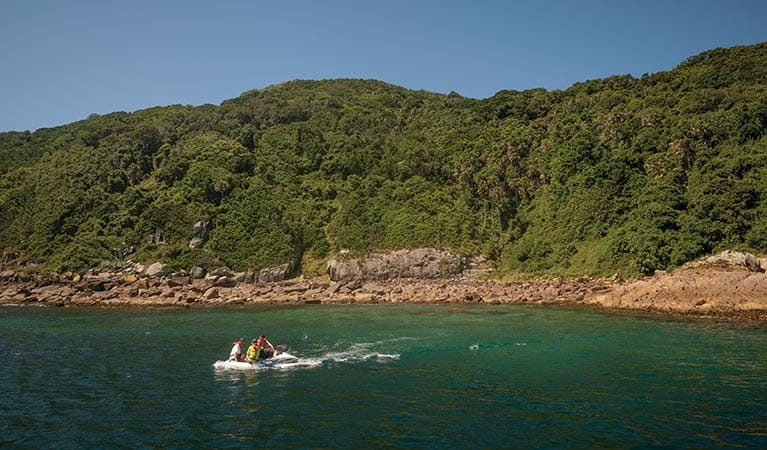 People visiting John Gould Nature Reserve by boat. Photo: John Spencer/DPIE