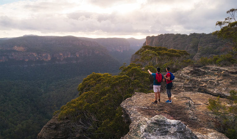 2 walkers on Pagoda lookout walking track in Wollemi National Park. Photo: Daniel Tran/DPIE