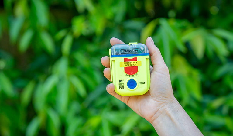 Person holding a personal locator beacon (PLB). Photo: John Spencer/DPIE