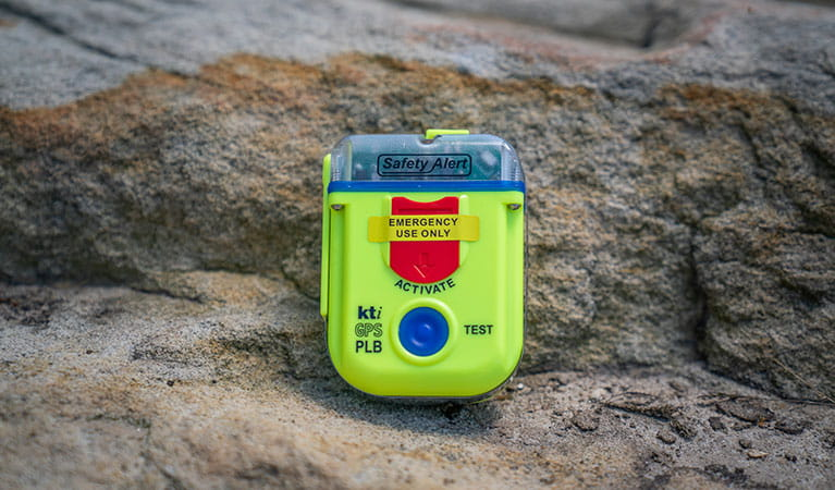 Personal locator beacon (PLB) resting on a rock. Photo: John Spencer/DPIE